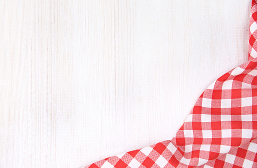 Red checkered picnic cloth on white wooden background empty copy space,food advertisement frame design.