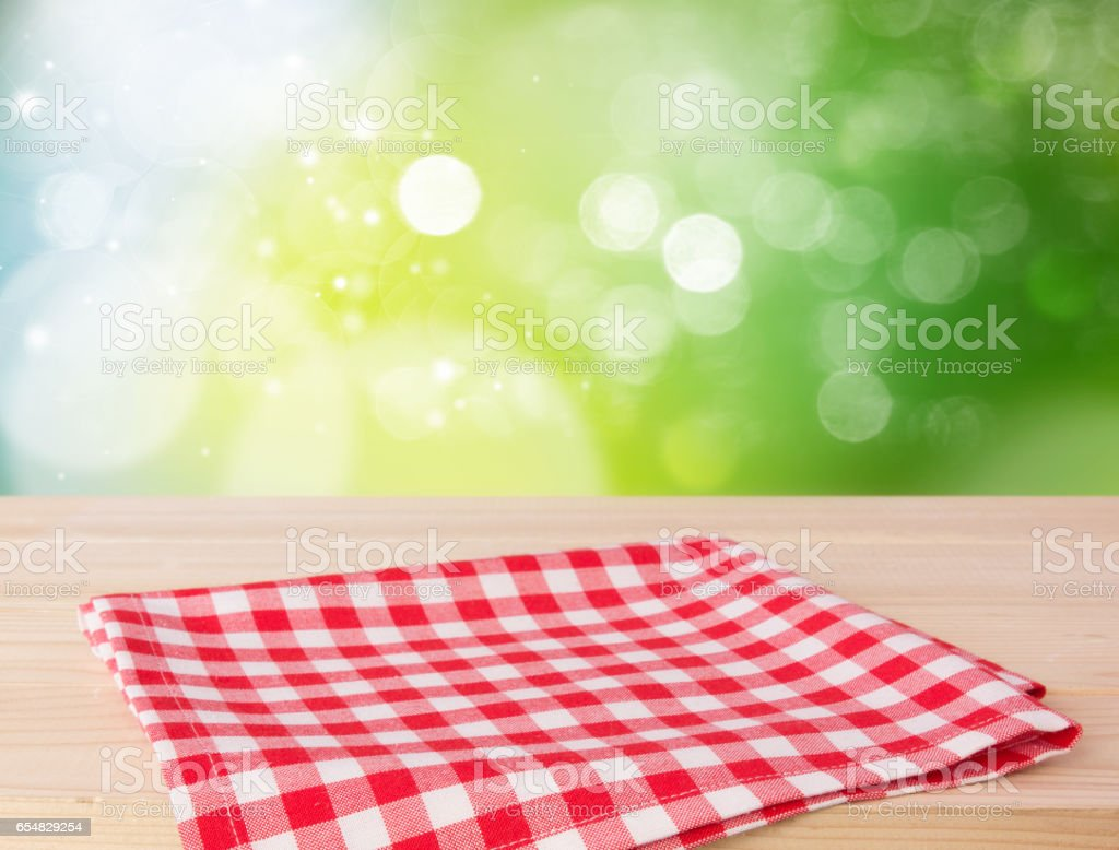 Red picnic cloth on wooden nature bokeh background. stock photo