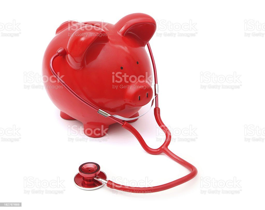 Red Piggy Bank and Stethoscope royalty-free stock photo