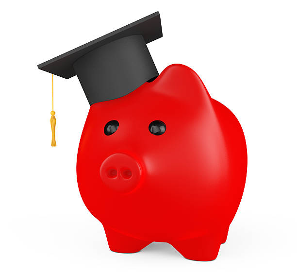 Red Piggy Bank with Graduation Hat stock photo