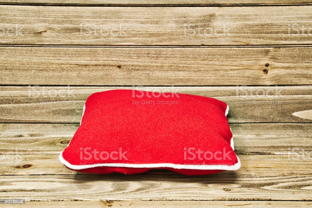 Red Pillow on Wood stock photo