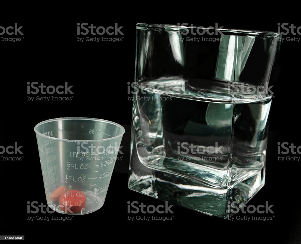 Red Pills and Daily Hospital Dosage royalty-free stock photo