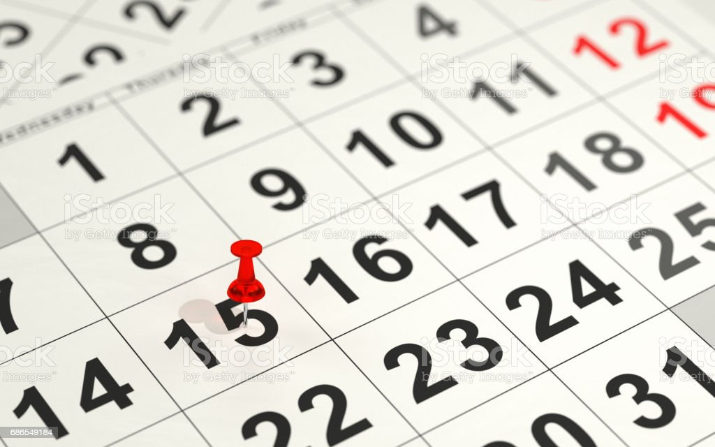 Red pin marking the 15th on a calendar royalty-free stock photo