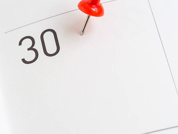 red pin on 30 calendar paper - number 30 stock photos and pictures
