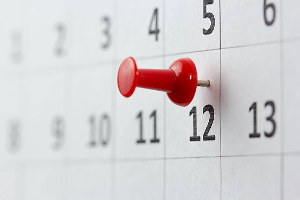 A red pin on the 12th of the month stock photo