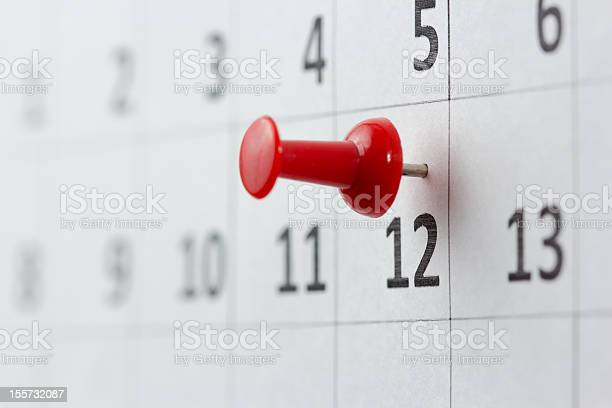A Red Pin On The 12th Of The Month Stock Photo - Download Image Now