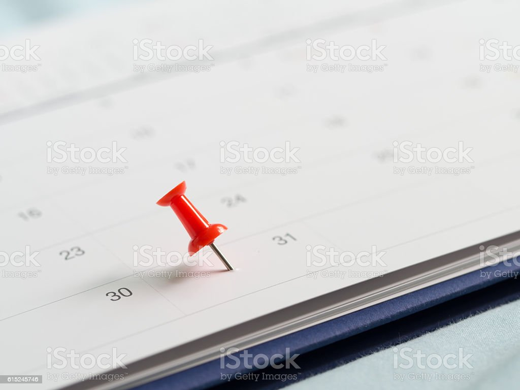 Red pin push on day 31 end month white calendar. stock photo