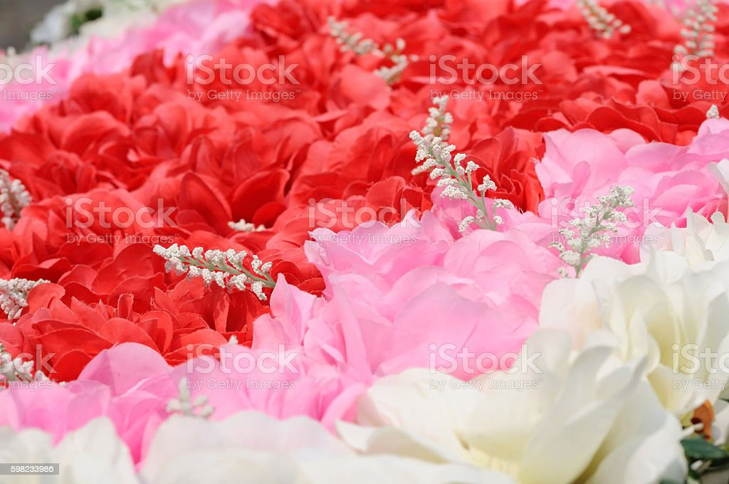 Red pink and white artificial flowers for background. foto royalty-free