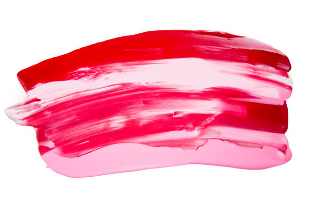 Red, pink and white colored paint, brush stroke make-up, isolated on white close up with copy space, no people stock photo