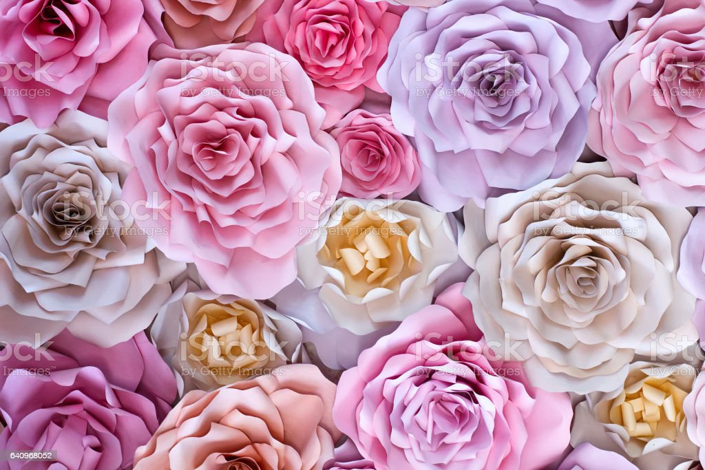 Red, pink, purple, brown, yellow and peach handmade paper roses stock photo