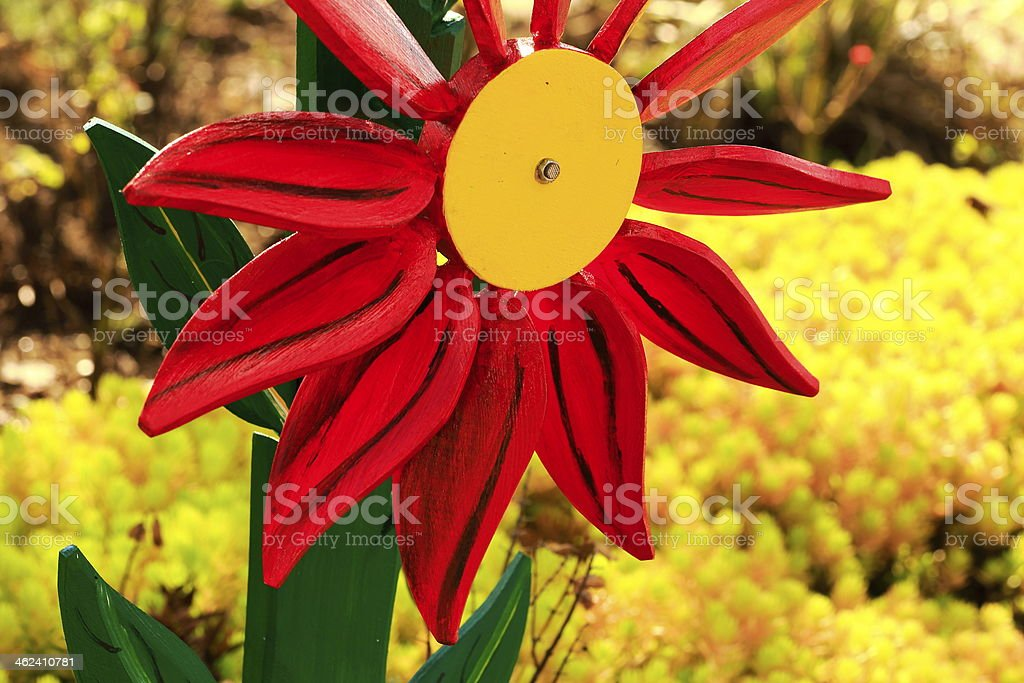 Red Pinwheel above yellow flowers field - Netherlands stock photo