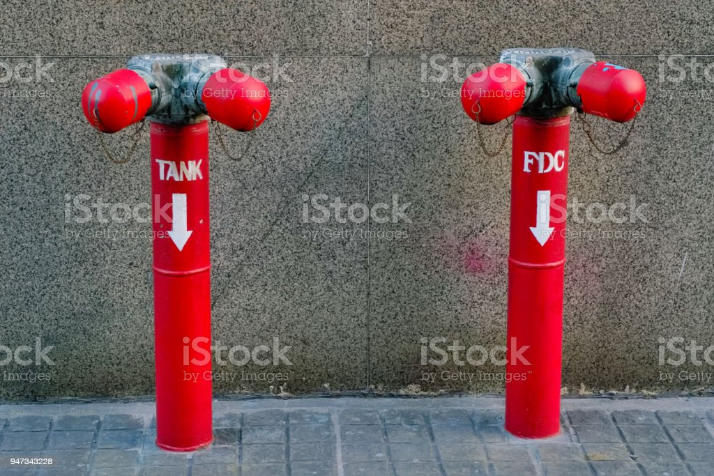 A Red Pipe Of Water Valve Tank And Fdc At The Outside Of Building