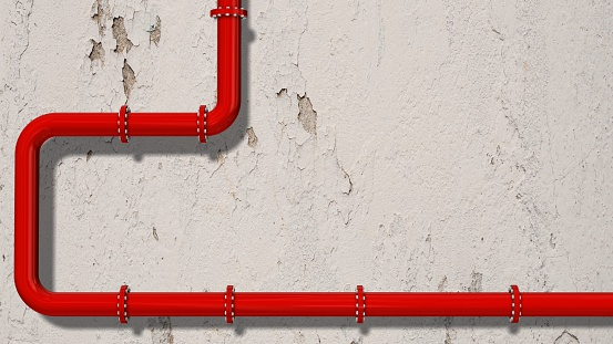 red pipeline  on a wooden wall - Space for text