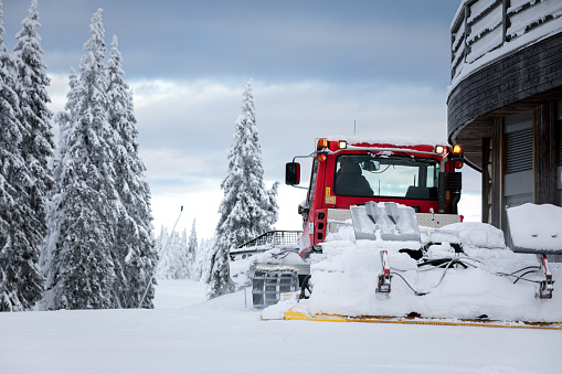 Red piste caterpillar for snow grooming