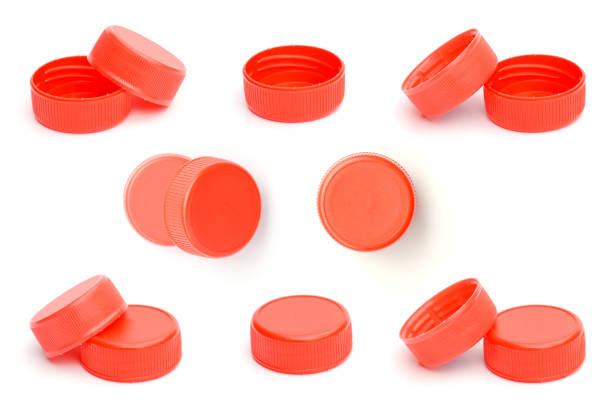 red plastic bottle cap on white background - plastic cap stock pictures, royalty-free photos & images