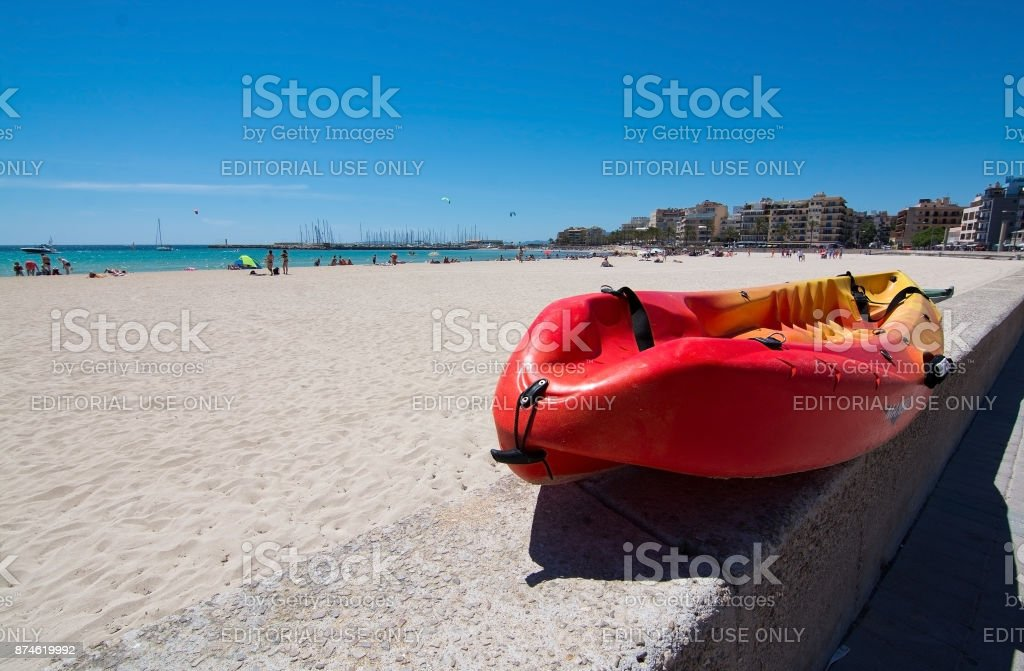 Red plastic canoe stock photo