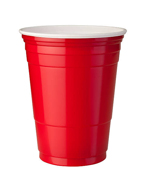Red Plastic Cup (clipping path) Red plastic party cup shown with shiny reflective highlight. This container is popular at parties because it is strong and disposable. The image is isolated on a white background, and includes a clipping path. disposable cup stock pictures, royalty-free photos & images