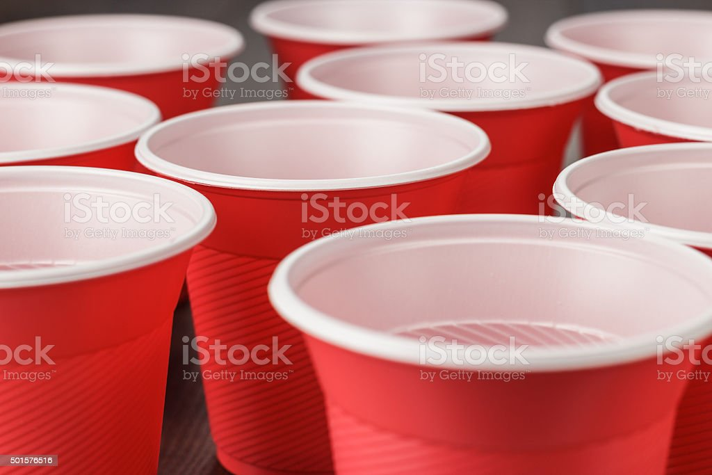 red plastic cups on the table stock photo