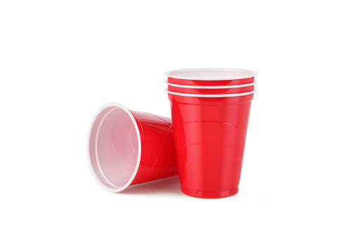 Red plastic disposable cups with clipping path.