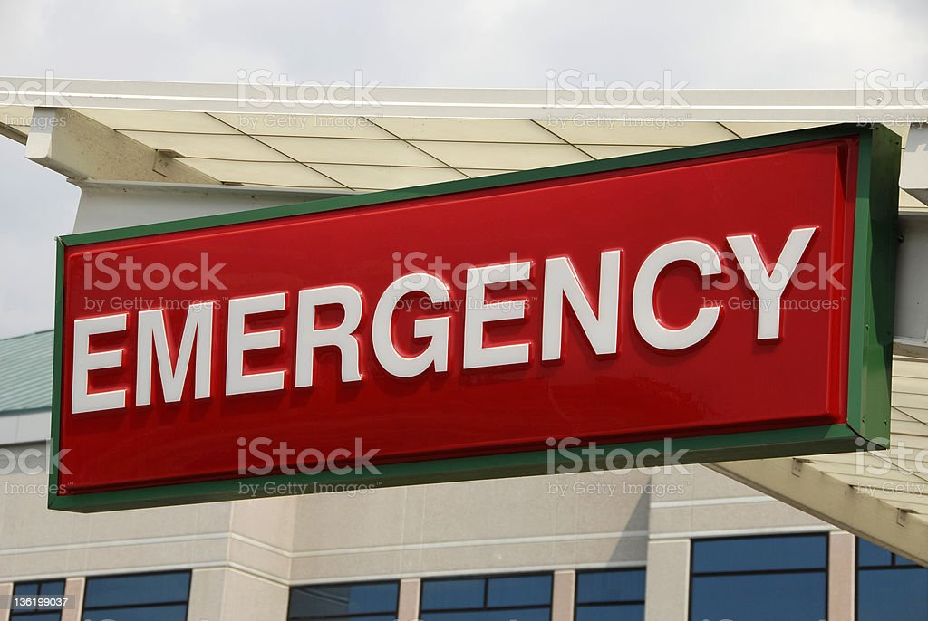 Red plastic emergency sign hung above entrance to hospital stock photo