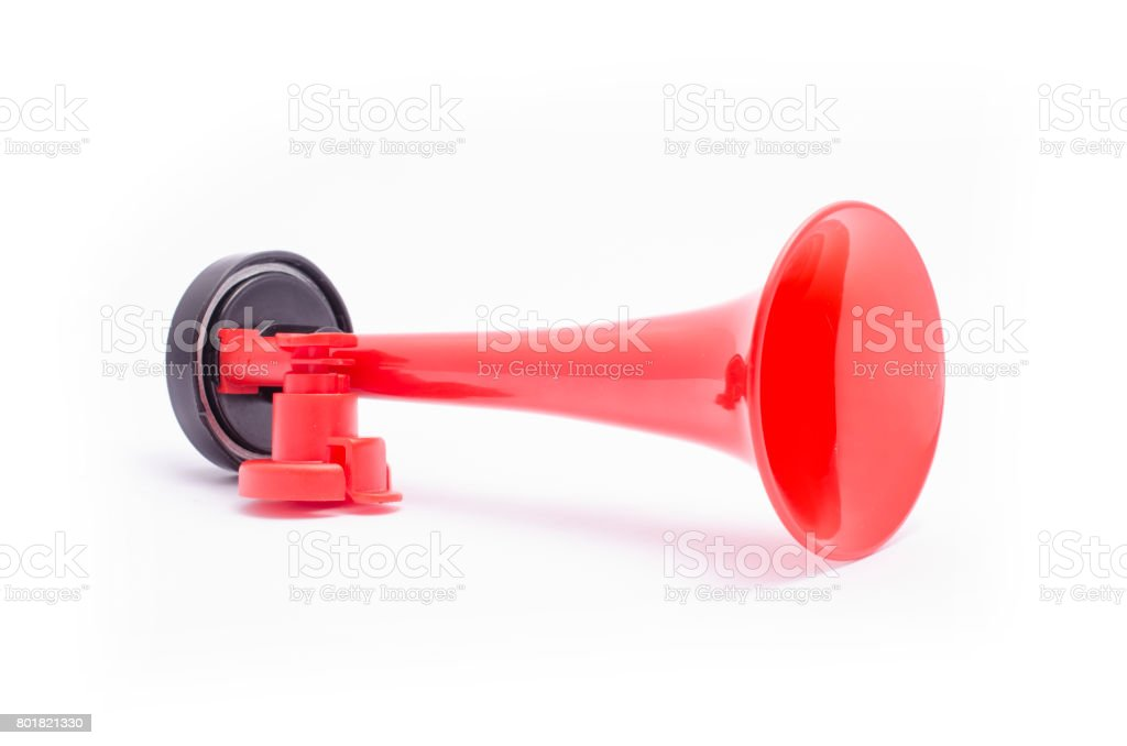 Red plastic horn isolated on white stock photo