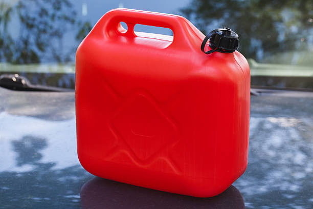 Red plastic jerry can stands on car hood – Foto