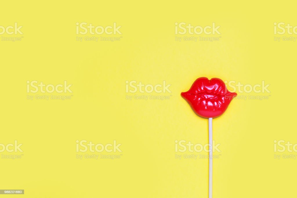 Red plastic lips for fun on yellow festive background. stock photo