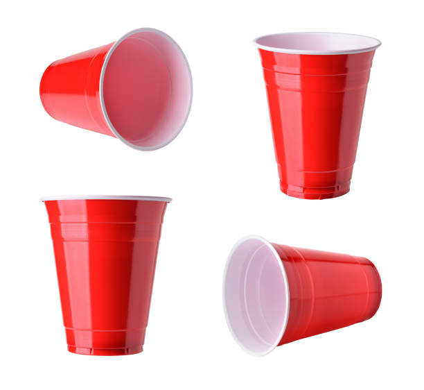 Red plastic party cups set, isolated on white background Red plastic party cups set, isolated on white background disposable cup stock pictures, royalty-free photos & images