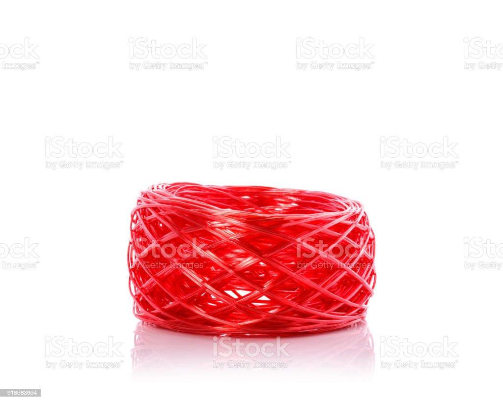 Red plastic rope. Studio shot isolated on white stock photo