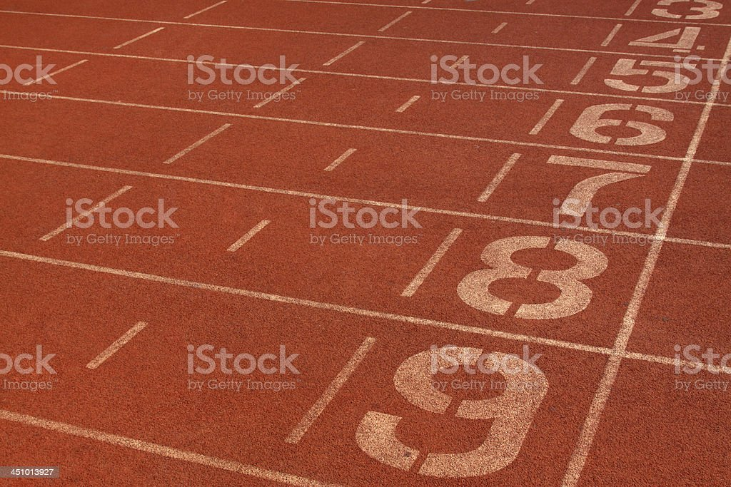 red plastic runway and numbers in a sports ground