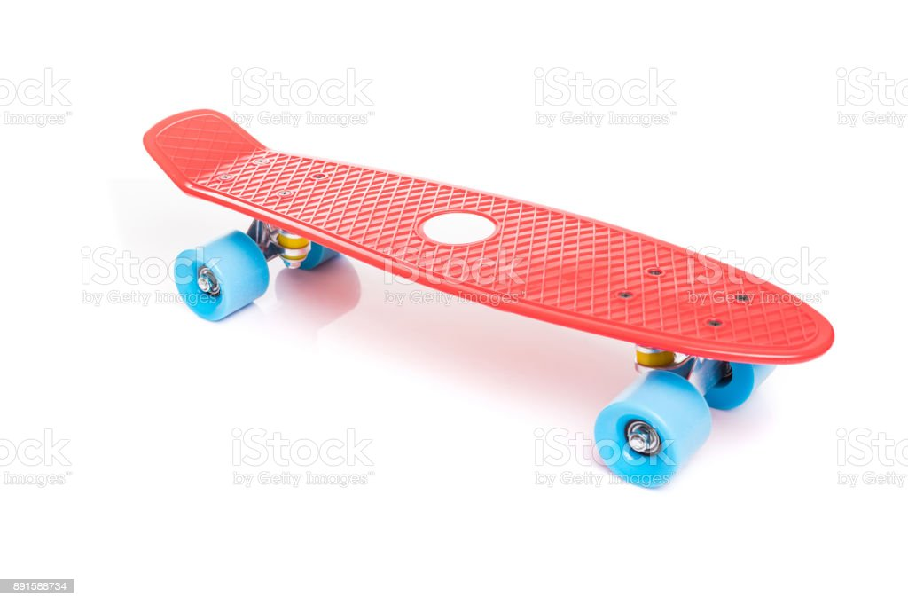 Red plastic skateboard on white background stock photo