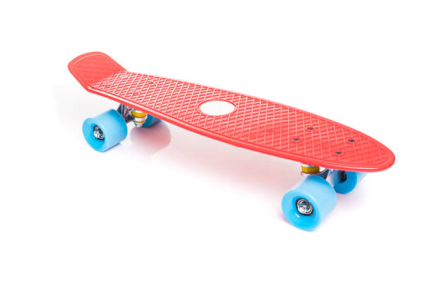 red plastic skateboard on white background - skateboard stock pictures, royalty-free photos & images