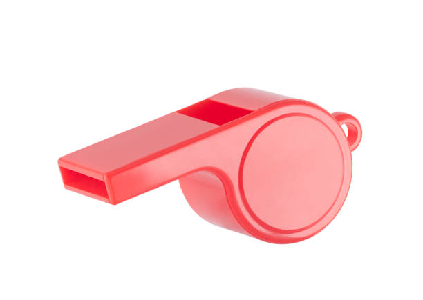 Red plastic whistle on a white background with clipping path stock photo