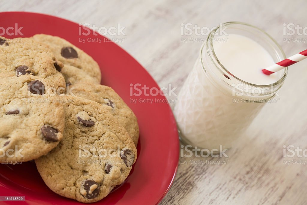 Red Plate of Cookies and Glass of Milk stock photo