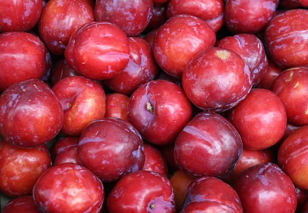 Red plum background stock photo