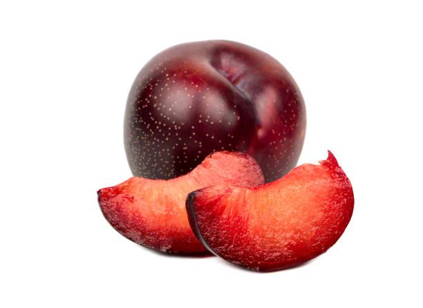 Red plum with slice stock photo