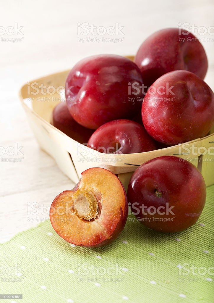 red plums in small basket 2 royalty-free stock photo