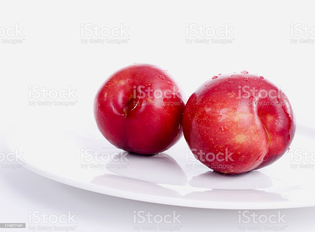 Red Plums on White royalty-free stock photo