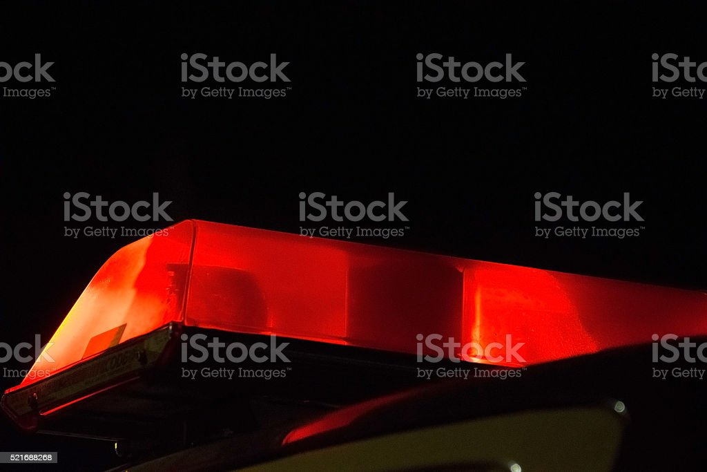 Red Police siren beacon light flashing on car stock photo