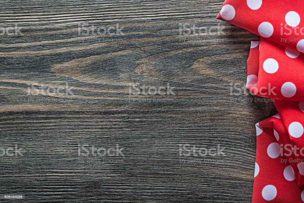 Red polka-dot table cloth on wood board copyspace stock photo