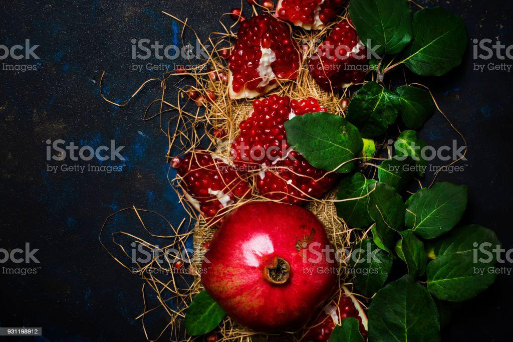 Red Pomegranate In The Straw stock photo