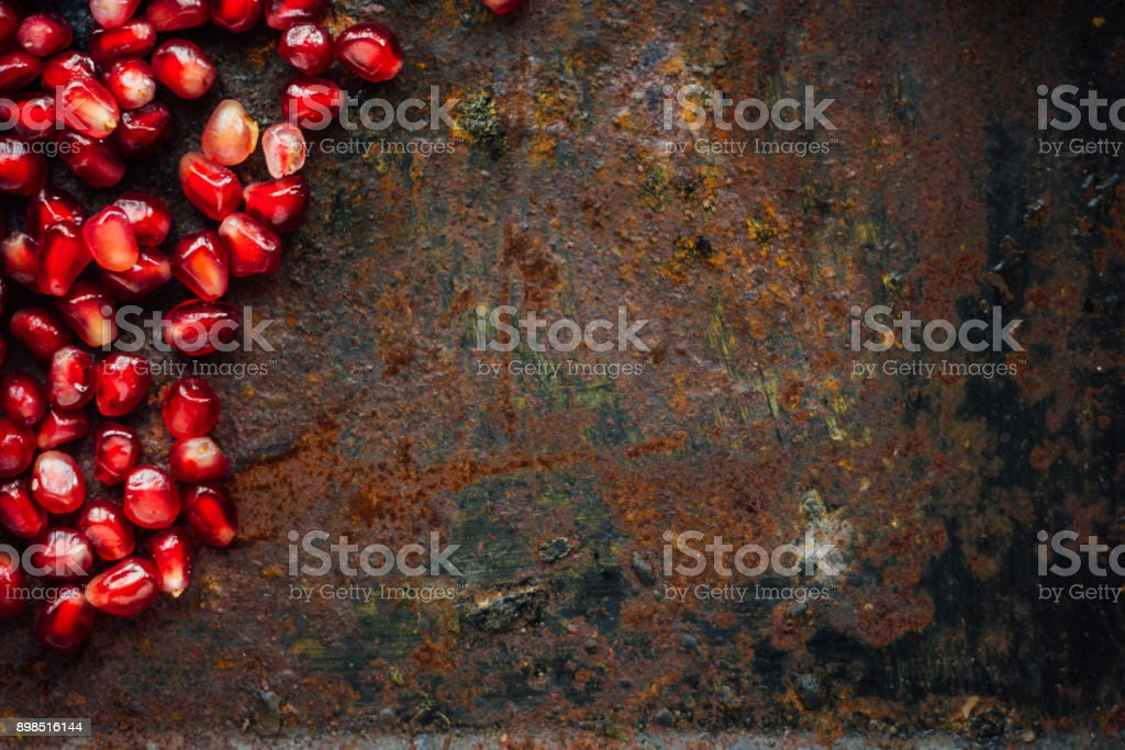 Red pomegranate seeds borders stock photo