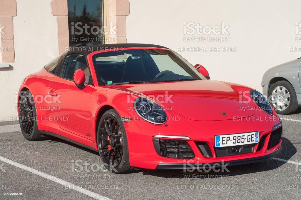 red Porsche 911 GTS carrera in outdoor parking stock photo