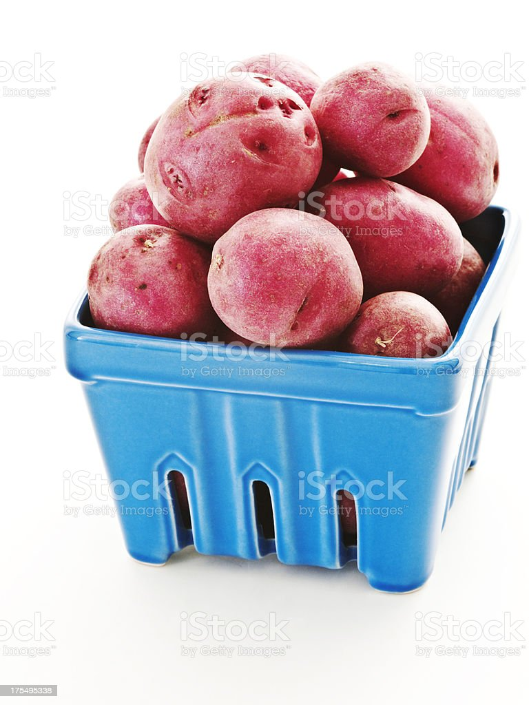 red potatoes. blue carton. stock photo