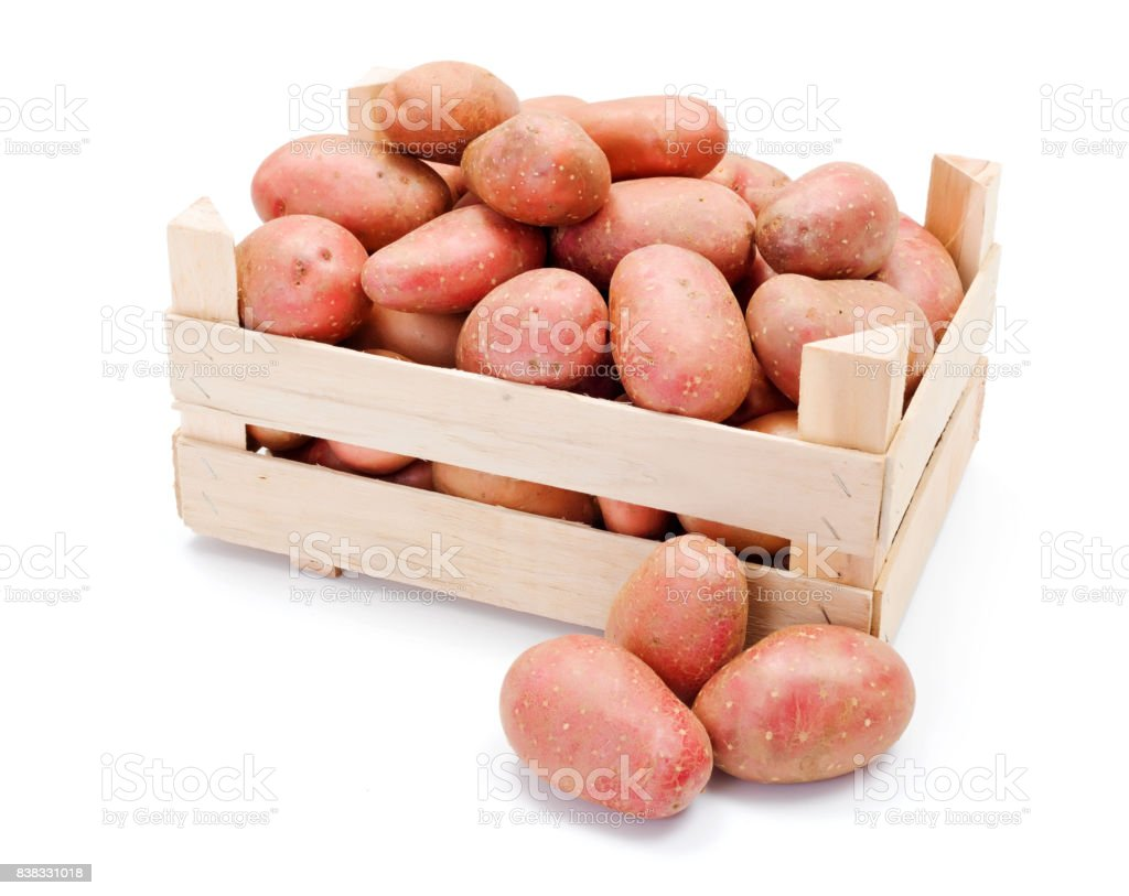 Red potatoes in wooden crate stock photo