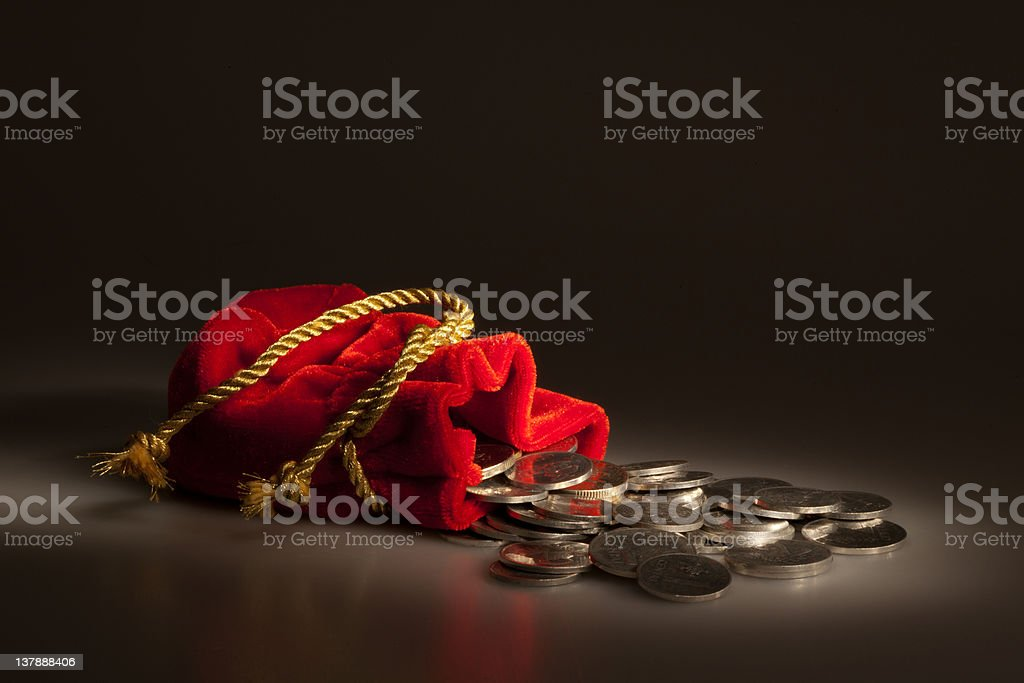 Red pouch with coins stock photo