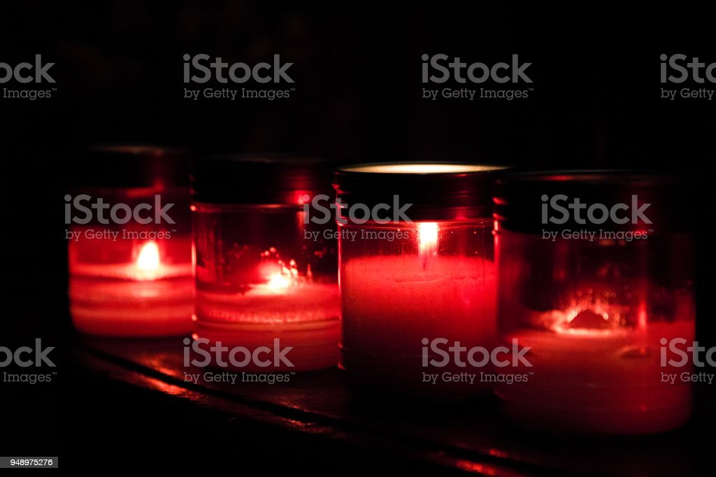 Red prayer candles burning in a row inside Catholic church stock photo & Royalty Free Red Prayer Candles In A Row Close Up In Catholic Church ...