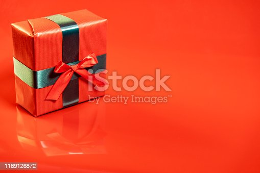 507751629 istock photo Red present on red background 1189126872