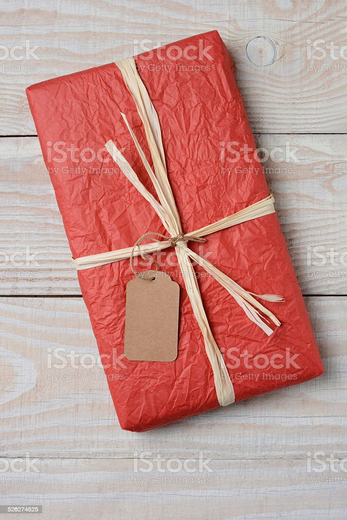 Red Present on White Wood stock photo