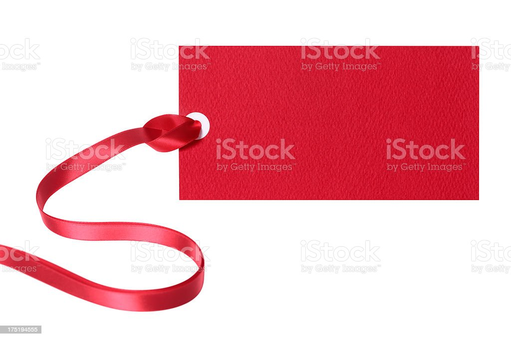 Red price tag with red ribbon attached on white background royalty-free stock photo
